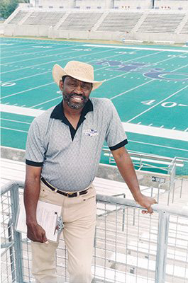 Football practice inside Herndon Stadium at Morris Brown College. Coach Solomon Brannan Jr.