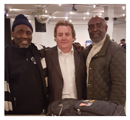 Solomon Brannan with BuccaneersFan Founding Director William Rader and Buccaneer Bobby Howard during 2017 Super Bowl party